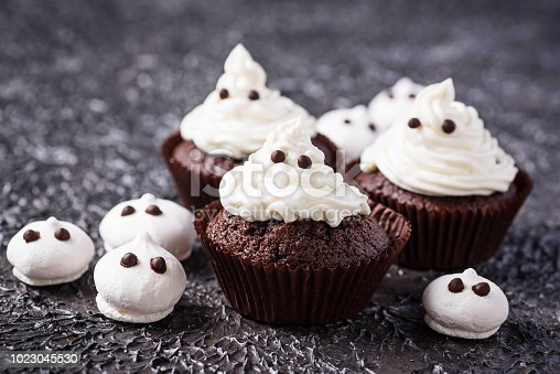 Cupcake in shape of ghost. Halloween treat for children party