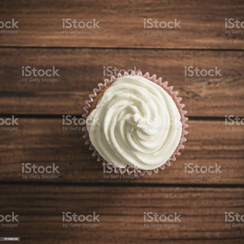 Cupcake on wood stock photo