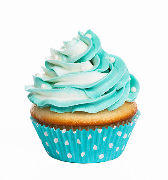 Cupcake Teal birthday cupcake with butter cream icing isolated on white. cupcake stock pictures, royalty-free photos & images
