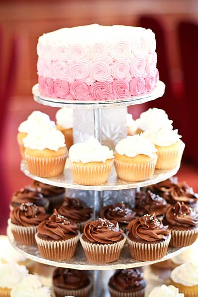 cupcake tier with pink cake - cupcake türme stock-fotos und bilder