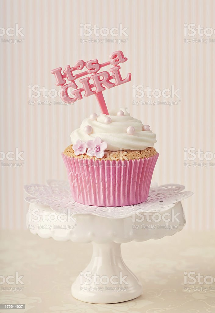 Cupcake with a cake pick stock photo