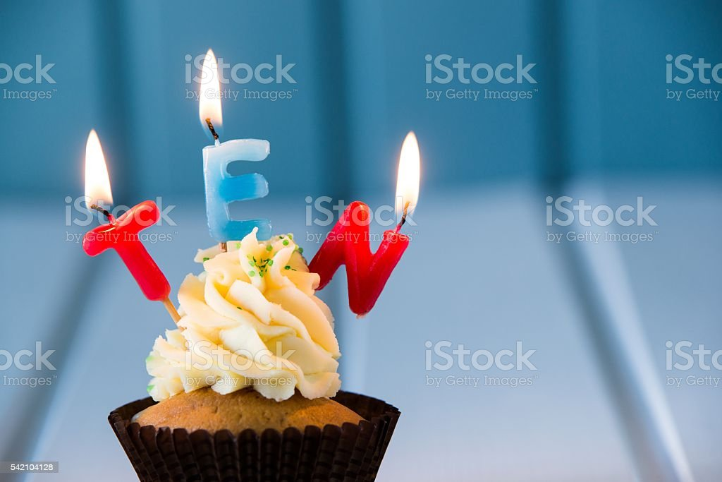 cupcake with a candles for 10 - tenth birthday stock photo