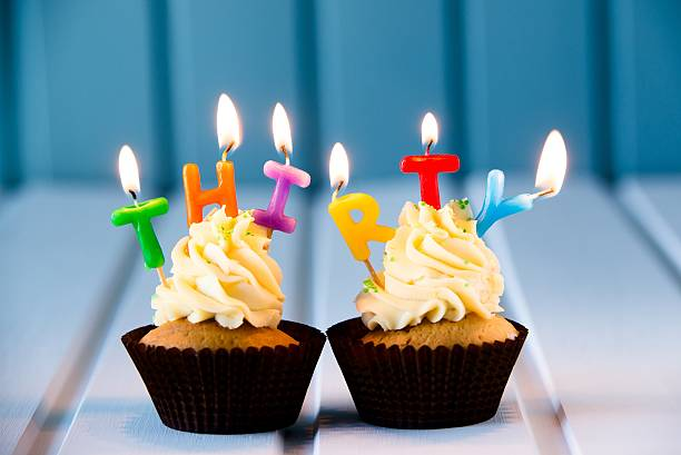 cupcake with a candles for 30 - thirtieth birthday - number 30 stock photos and pictures