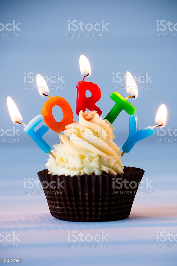 cupcake with a candles for 40 - fortieth birthday stock photo