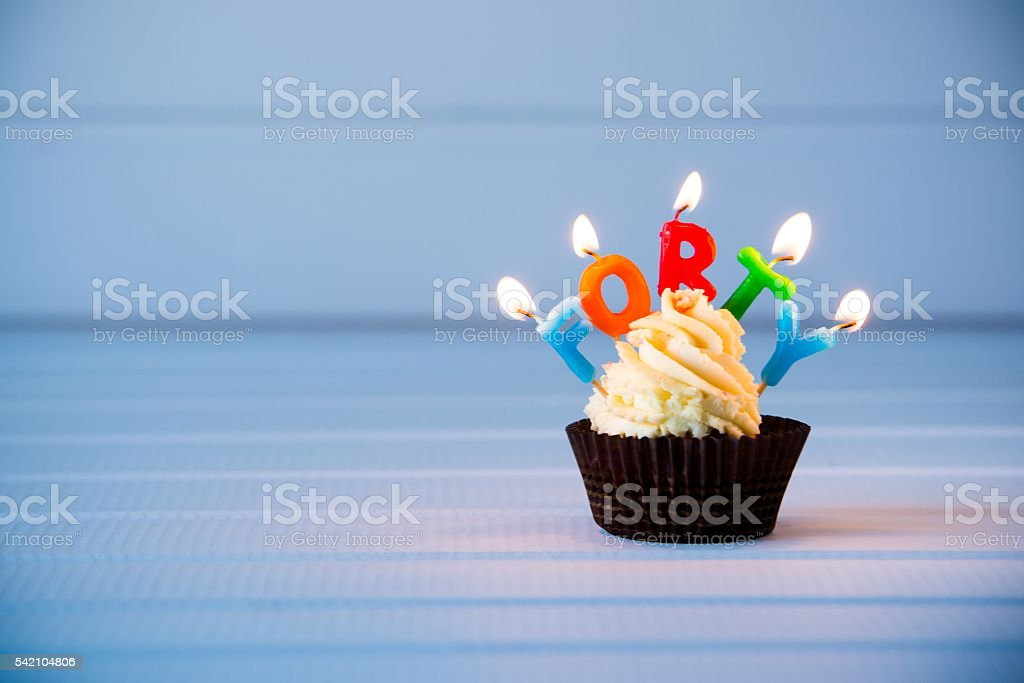 cupcake with a candles for 40 - fortieth birthday Birthday's cake - cupcake with a candles for 40 - fortieth birthday . Happy birthday ! 40-44 Years Stock Photo