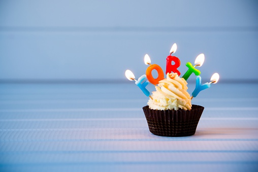 Cupcake With A Candles For 40 Fortieth Birthday Stock Photo - Download Image Now