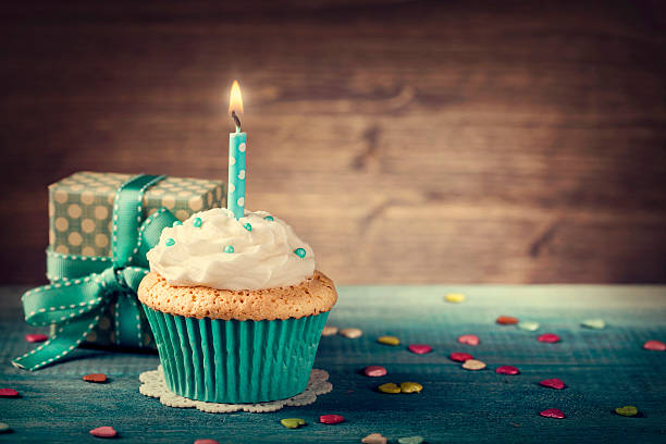 Cupcake with birthday candle stock photo