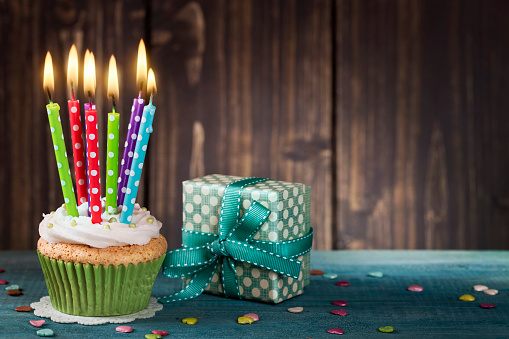 istock Cupcake with birthday candles 599990020