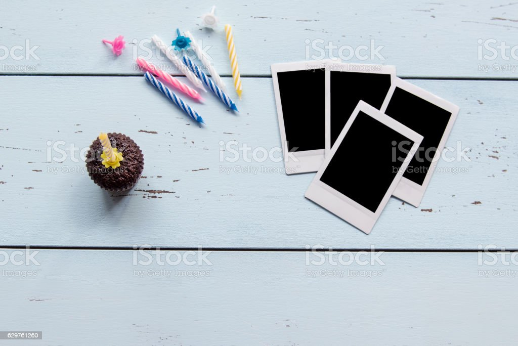 Cupcake with blank photos frame on wood for the birthday stock photo