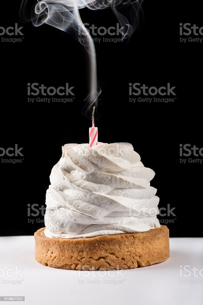 Cupcake with blown out candle stock photo