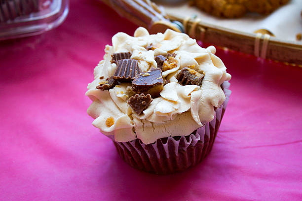 Cupcake with Chunks of Reeses Pieces and Cream stock photo