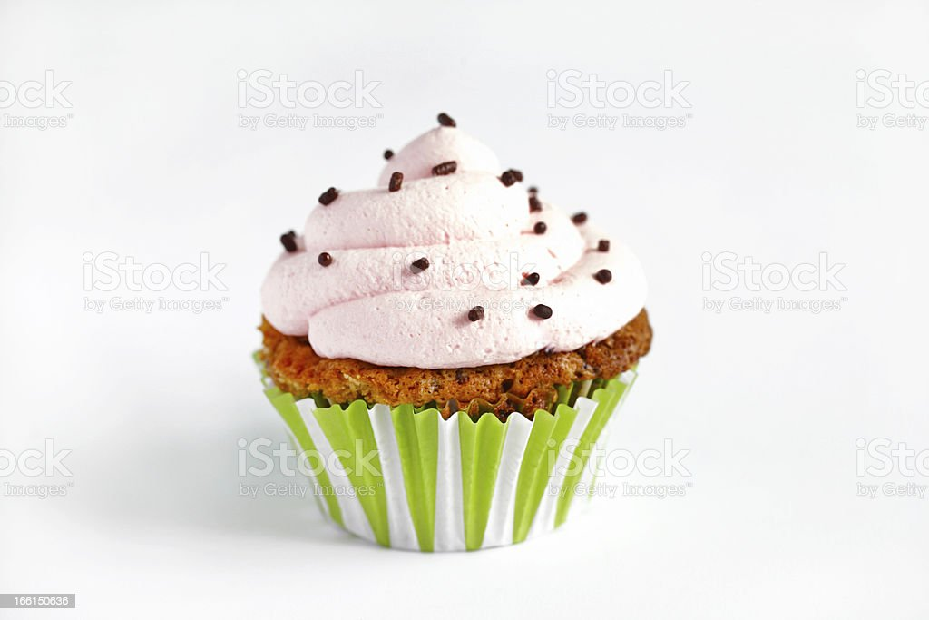 Cupcake with pink cream icing, isolated on white background royalty-free stock photo