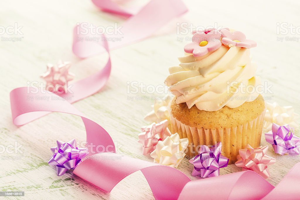 Cupcake with pink ribbon royalty-free stock photo