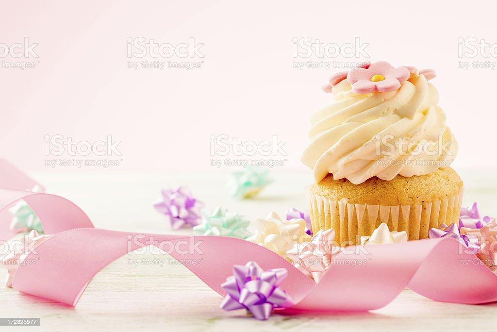 Cupcake with pink ribbon royalty-free stock photo