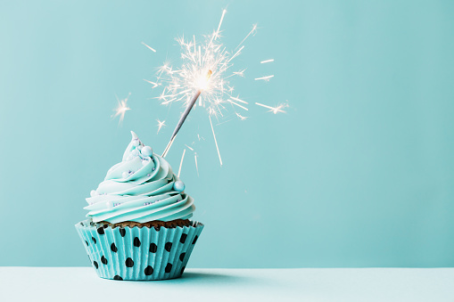 istock Cupcake with sparkler 488719370