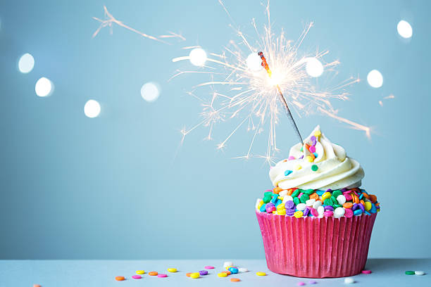 cupcake with sparkler - birthday cake stock photos and pictures