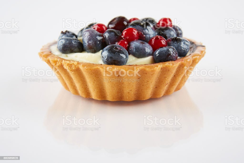Cupcake with sweet blueberries and currants. stock photo