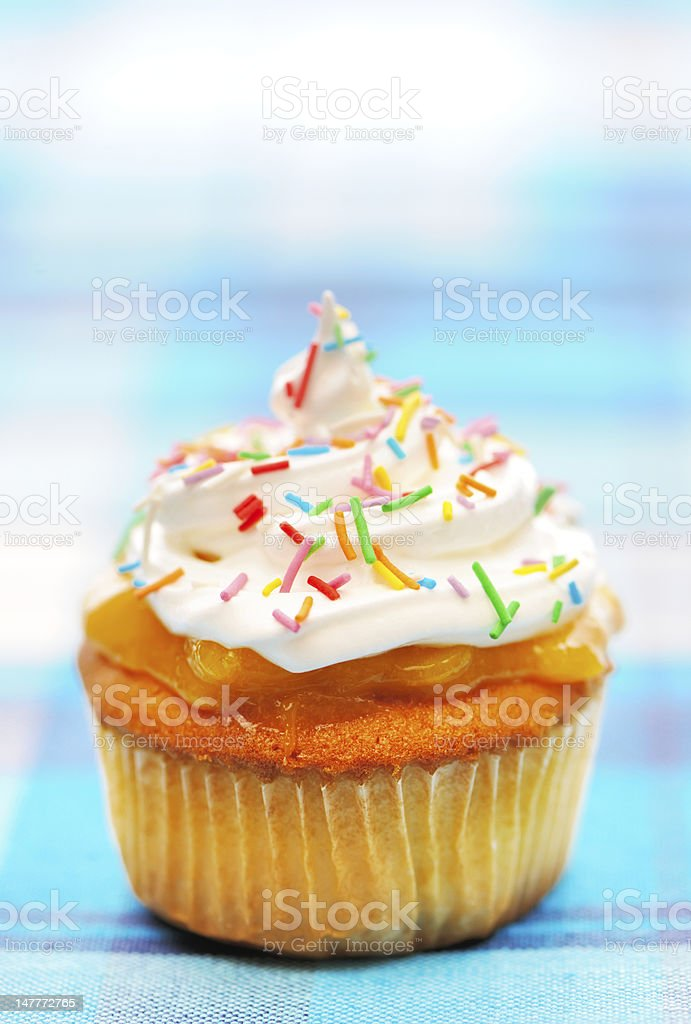 Cupcake with whipped cream royalty-free stock photo