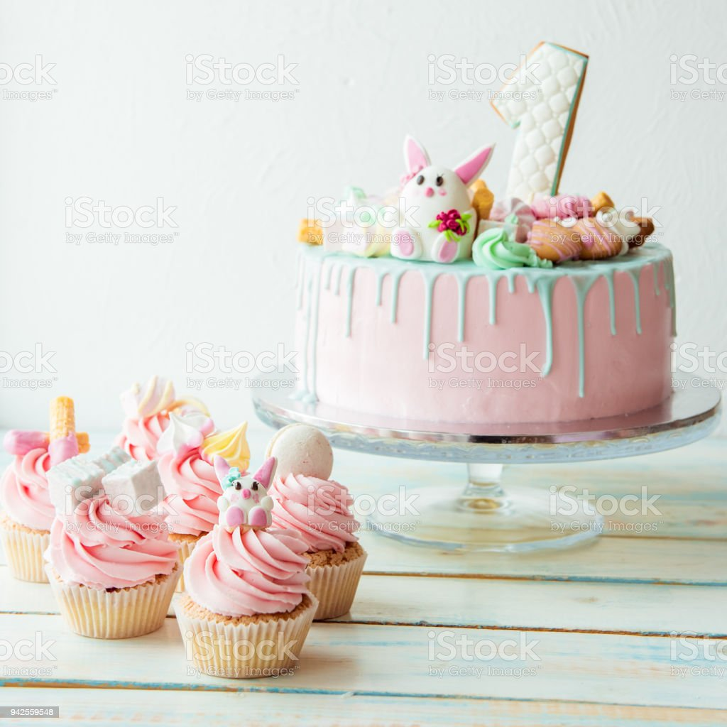Cupcakes And Pink Birthday Cake One Year Old