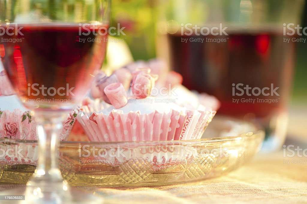 Cupcakes and red wine. royalty-free stock photo