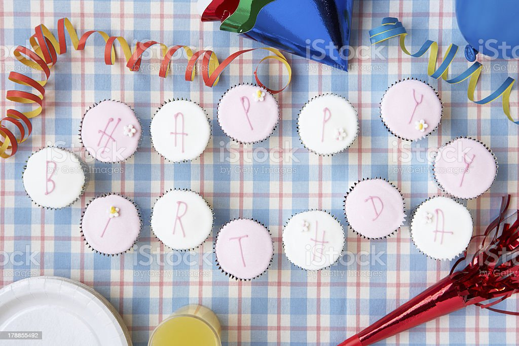 Cupcakes spell out happy birthday royalty-free stock photo