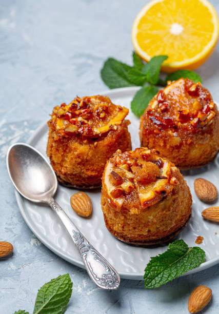 Cupcakes with caramelized orange and almonds. stock photo