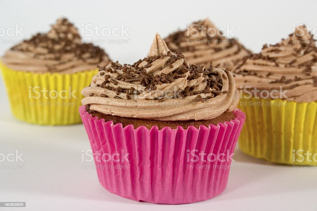 Cupcakes with Chocolate Icing and Sprinkles stock photo