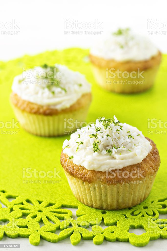 Cupcakes with coconut and lime frosting royalty-free stock photo