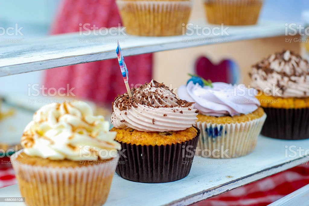 cupcakes with cream and berries stock photo