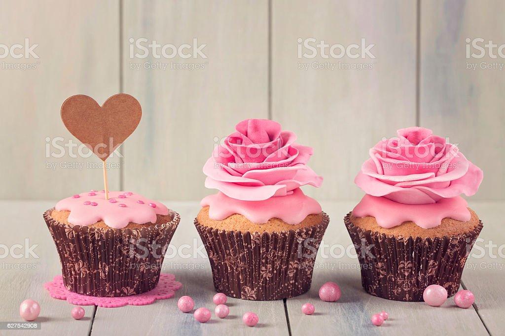 Cupcakes with heart cakepick stock photo