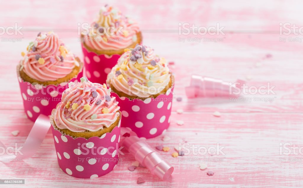 Cupcakes with pink and white icing royalty-free stock photo