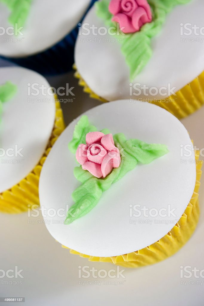 Cupcakes with Pink Icing Roses stock photo