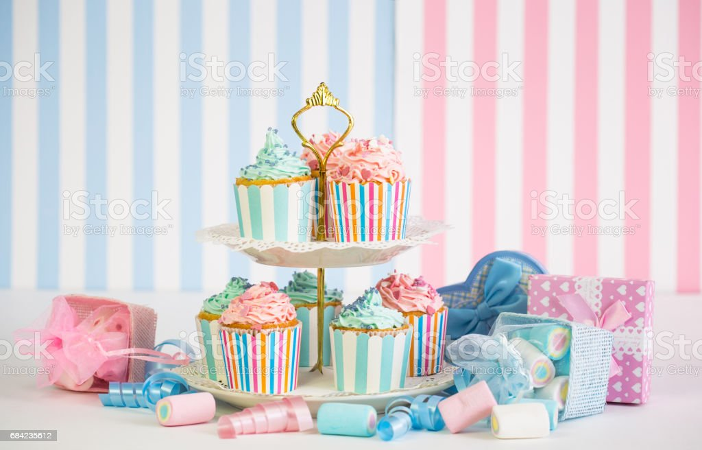 Cupcakes with pink, white and blue icing royalty-free stock photo