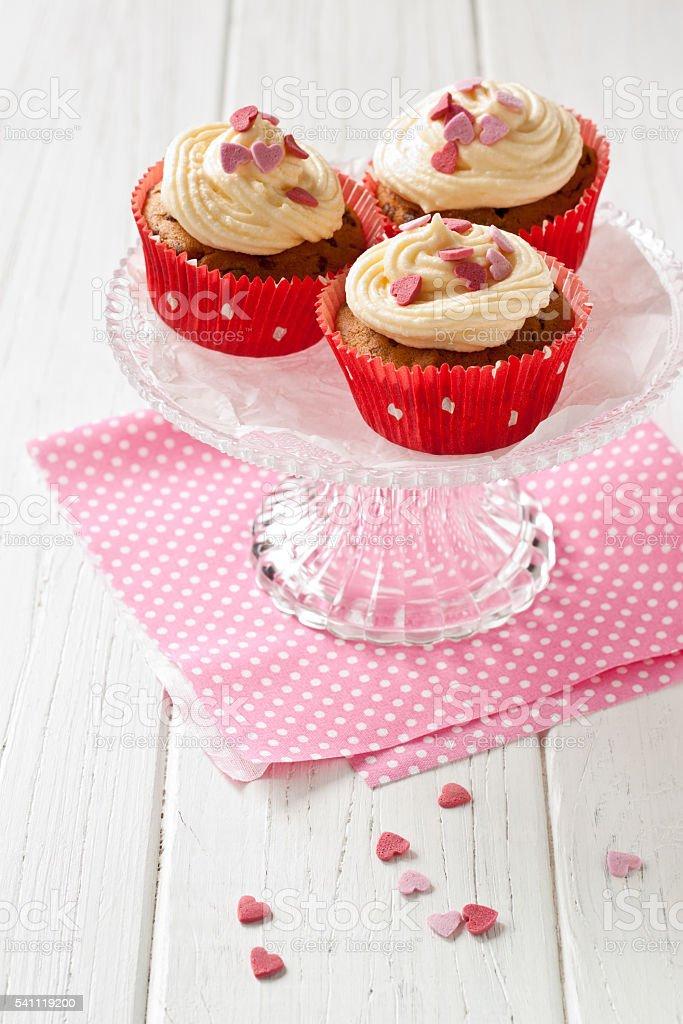 Cupcakes with sugar hearts stock photo