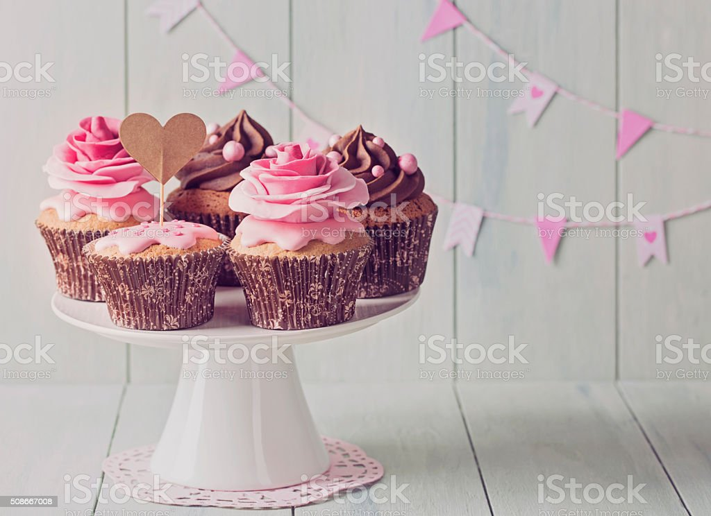 Cupcakes with sweet rose flowers stock photo