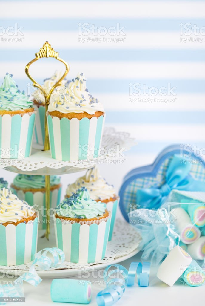 Cupcakes with white and blue icing royalty-free stock photo