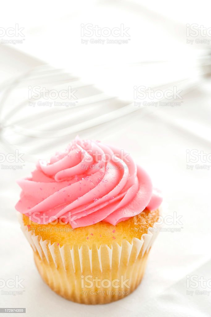 Cupecake with whisk stock photo