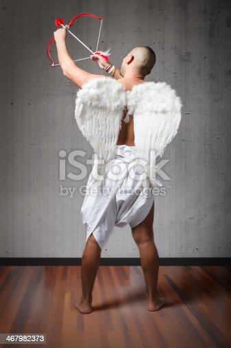 istock Cupid back side hitting target 467982373