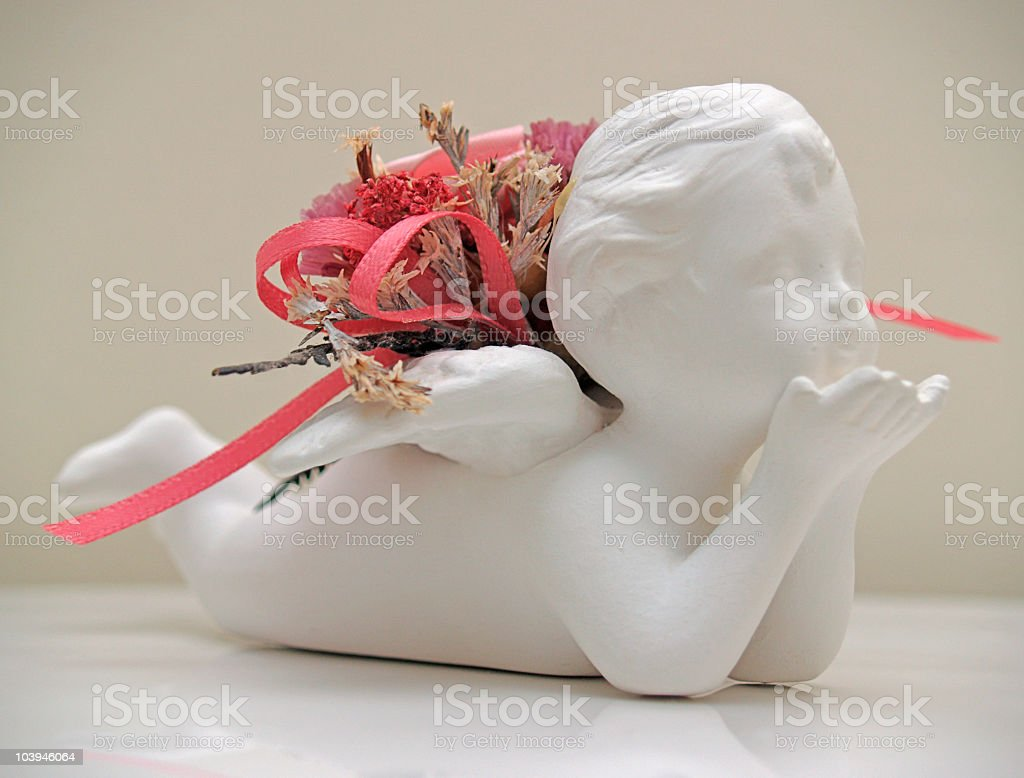 Cupid decoration with dry flowers and ribbon royalty-free stock photo