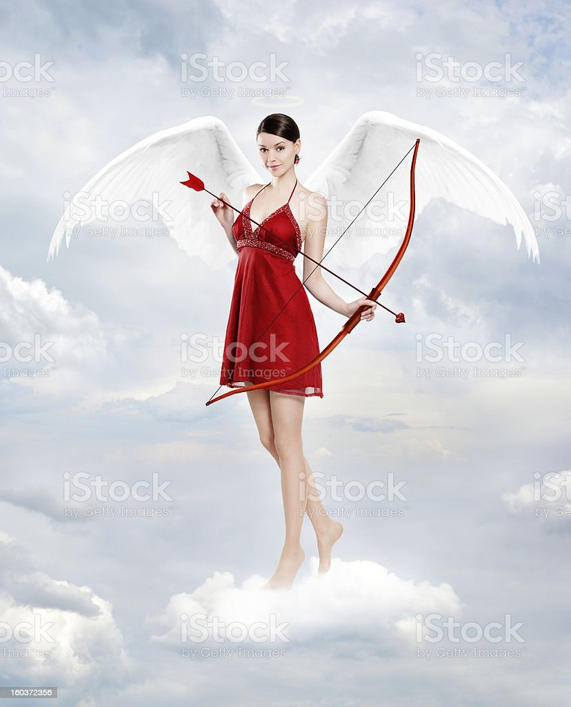 Cupid in clouds stock photo