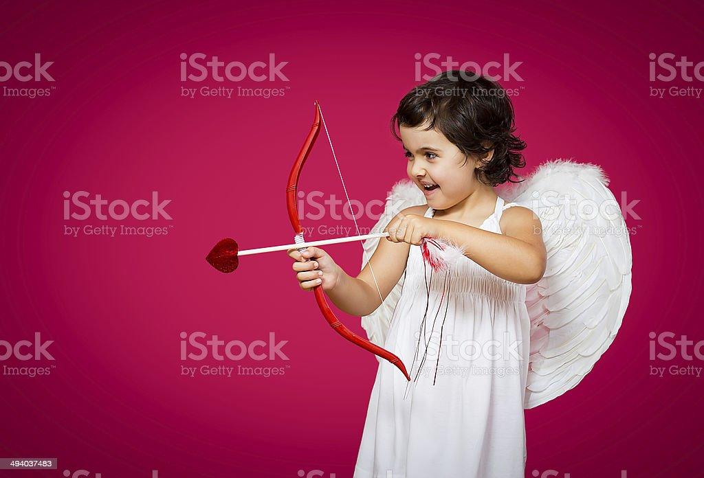 cupid little girl stock photo