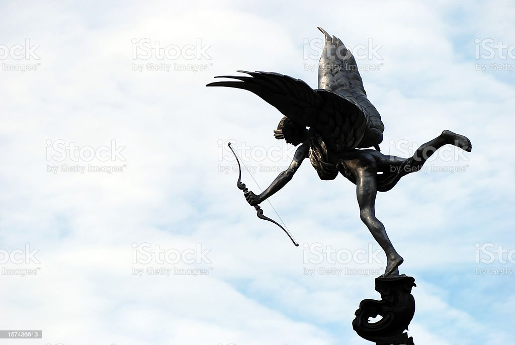 Cupid statue silhouette in Sefton Park royalty-free stock photo