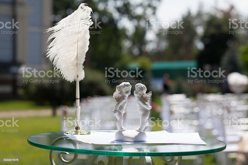 Cupids, pen on the table for the wedding registration stock photo