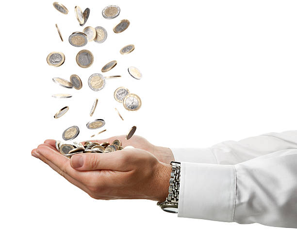 Cupped Businessman Hands Catching Falling Euro Coins Isolated On White Concept of a pair of arms isolated on white catching falling Euro coins. european union coin stock pictures, royalty-free photos & images
