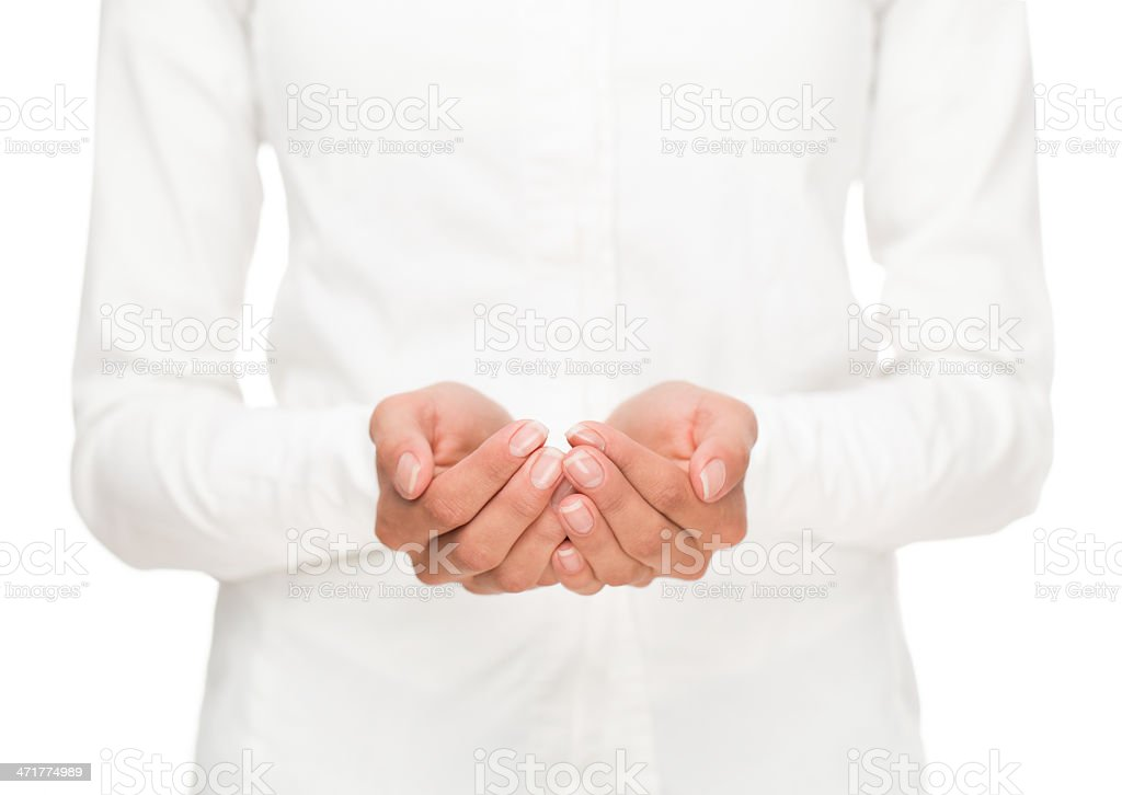 Cupped female hands stock photo