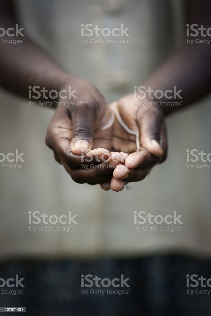 Cupped hands of girl with water stock photo