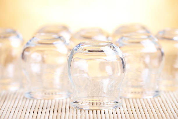 cupping-glass - cupping therapy stock photos and pictures