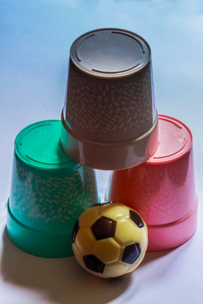3 cups and a ball stock photo