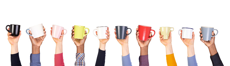 Cups and mugs in hands isolated on white background