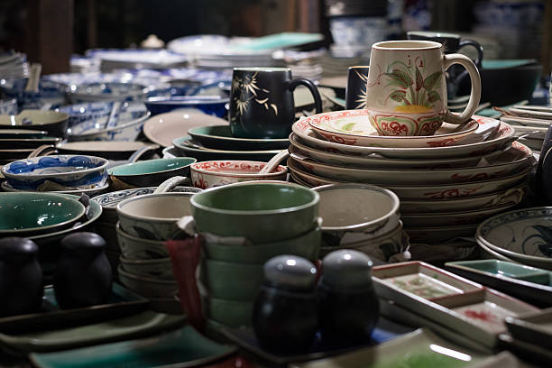 Cups and saucers Cups, plates, crockery for sale at the Russian Market in Phnom Penh, Cambodia apostrophe stock pictures, royalty-free photos & images